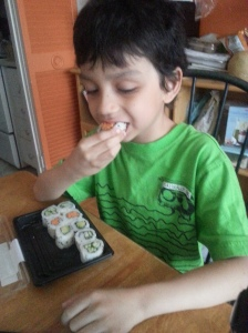 Boy sure loves him some veggie sushi!